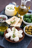 Cheeses - mozzarella, feta cheese and pickles, vertical Stock Photo