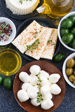 Cheeses - mozzarella, feta cheese and pickles, vertical Stock Photos