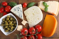 Cheeses and olives. Stock Photo