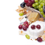 Cheeses, red and green grapes, crackers,  Stock Images