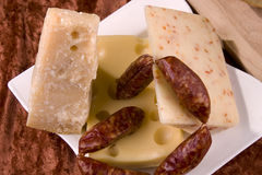 Cheeses and sausages stock photo