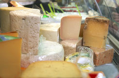 Cheeses on show window Royalty Free Stock Image