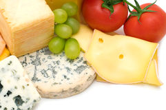 Cheeses and vegetables Stock Images