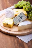 Cheeses with white grapes Royalty Free Stock Photo