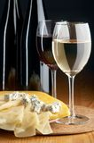 Cheeses and wines Royalty Free Stock Images