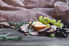 Cheeses on wood Stock Images