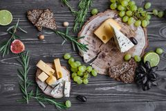 Cheeses on wood Stock Photos