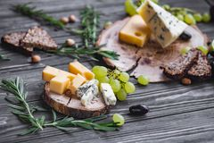 Cheeses on wood Stock Photography