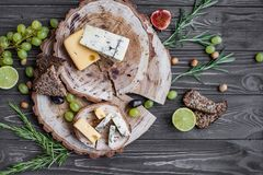 Cheeses on wood Stock Image