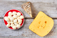 Cheeses on wooden background. Royalty Free Stock Images