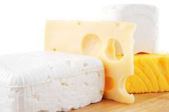 Cheeses on wooden board Stock Photo