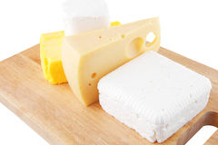 Cheeses on wooden board Royalty Free Stock Image