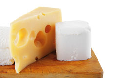Cheeses on wooden board Stock Image