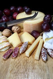 Cheeses on wooden board Stock Photos