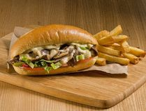 cheesesteak sandwich on cutting board Royalty Free Stock Photo