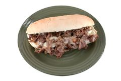 Cheesesteak on white. Sizzling cheesesteak sandwich on white Stock Images