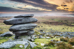 The Cheesewring in Cornwall. Sunset at the Cheesewring on Bodmin Moor in Cornwall, a weathered natural rock formation made up of  precariously balanced granite Royalty Free Stock Images