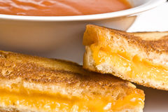 Cheesy. Grilled cheese sandwich on a white plate shot with a macro lens Stock Images