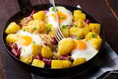 Cheesy Bacon And Egg Hash. Selective focus stock photos