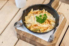 Cheesy baked macaroni. And cheese pasta portion with parmesan sprinkled on top - soft focus point Royalty Free Stock Photos