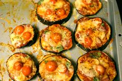 Cheesy baked paleo and keto eggplant pizza rounds are delicious. Everyone cutting back on carbohydrates can enjoy these healthy eggplant pizza rounds with fresh stock photo