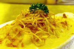 Cheesy basked rice Stock Photography