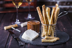 Cheesy breadsticks with chili and thyme Royalty Free Stock Photos