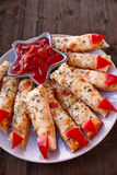 Cheesy Breadsticks Witch Fingers Royalty Free Stock Photography