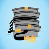 Cheesy ending film. Stack of film canisters with cheesy ending film Royalty Free Stock Photo