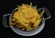Cheesy french fries on a metal plate royalty free stock photos