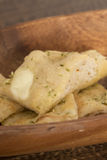 Cheesy garlic bread in a wooden dish Stock Photography