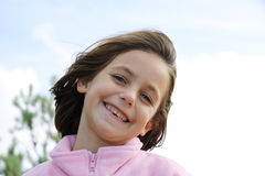 Cheesy grin. Portrait of a caucasian child with a very cheesy grin showing missing teeth Stock Photo