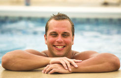 Cheesy Grin. Model being silly in a swimming pool Royalty Free Stock Photo
