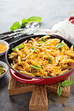 Cheesy pasta bake with ground beef and herbs Stock Photography