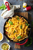Cheesy pasta bake with ground beef and herbs Stock Images