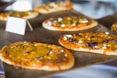 Cheesy pizza breads on tray Stock Photography
