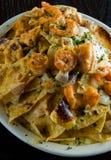 Cheesy seafood nachos Royalty Free Stock Image
