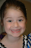 Cheesy Smile. Five year old girl with a silly smile on her face Royalty Free Stock Photo