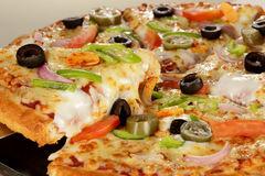 Cheesy vegetable pizza. stock photo