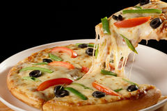 Cheesy vegetable pizza. Stock Photography