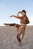 Cheetah woman dances in desert Stock Photography