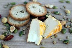 Cheeze snack with crackers and mixed nuts on a wooden board. Cheeze Royalty Free Stock Photography