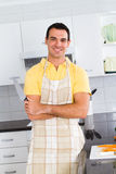 Chef. Young chef with apron in a modern home kitchen Royalty Free Stock Image