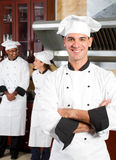 Chef. Happy male professional chef in commercial kitchen Stock Photo
