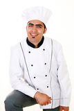 Chef. Handsome smiling kitchen chef in uniform, a vertical portrait Royalty Free Stock Image