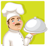 Chef. Cute smiling chef with a tray on a green background Royalty Free Stock Images