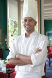 Chef. Standing at restaurant proud and smiling royalty free stock image