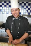 Chef. Asian chef cooking and smiling Royalty Free Stock Image