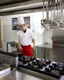 Chef. Young chef working in his cuisine, prepearing some food royalty free stock image