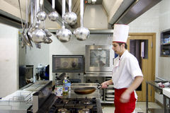 Chef. Young chef working in his cuisine, prepearing some food stock image